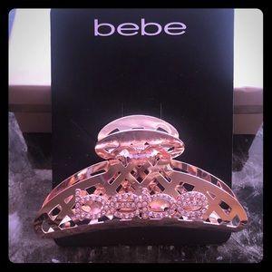 Bebe rose gold hair clip.